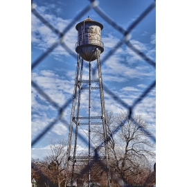 Tioga Water Tower Through a Fence